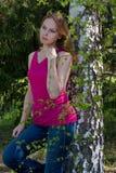 Menina e vidoeiro bonitos. Imagens de Stock Royalty Free