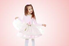 Menina elegante em um vestido cor-de-rosa Foto de Stock Royalty Free