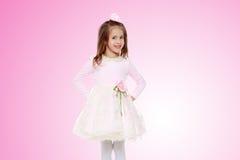 Menina elegante em um vestido cor-de-rosa Imagens de Stock