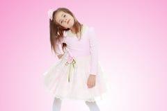 Menina elegante em um vestido cor-de-rosa Fotografia de Stock