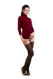 Menina elegante no vermelho sobre o branco Fotografia de Stock Royalty Free