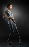 Menina elegante nova na calças de ganga Imagens de Stock Royalty Free