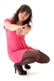 Menina em apontar cor-de-rosa Fotografia de Stock Royalty Free