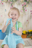 Menina em aventais azuis, imagens de stock