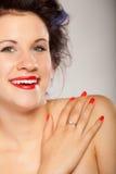 Menina em encrespadores de cabelo no cinza Imagem de Stock Royalty Free