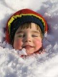 Menina em equipamentos coloridos do inverno Fotos de Stock Royalty Free