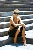 Menina em escadas Imagens de Stock