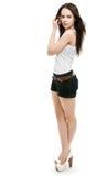 A menina em estar dos shorts Imagens de Stock