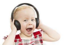 Menina em fones de ouvido grandes foto de stock royalty free