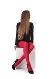 A menina em meias vermelhas Imagens de Stock Royalty Free