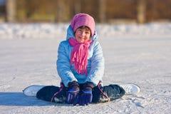 Menina em patins Fotografia de Stock
