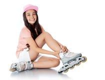 Menina em patins de rolo Imagem de Stock Royalty Free