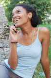 Menina em seu telemóvel Fotos de Stock Royalty Free
