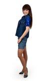 Menina em shorts da sarja de Nimes Fotografia de Stock Royalty Free