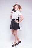 Menina em sorrisos da saia e do revestimento Fotos de Stock Royalty Free