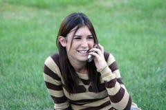 Menina em telefones de pilha Fotos de Stock Royalty Free