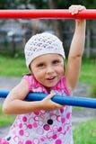 Menina em um campo de jogos Fotos de Stock Royalty Free