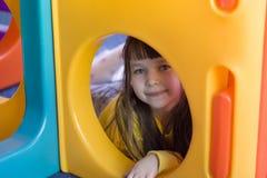 Menina em um campo de jogos Fotografia de Stock