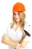 Menina em um capacete alaranjado com o martelo, isolado Imagem de Stock Royalty Free