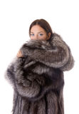 Menina em um casaco de pele Fotografia de Stock Royalty Free