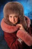 Menina em um casaco de pele Foto de Stock Royalty Free