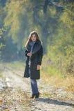 Menina em um casaco de pele Imagem de Stock