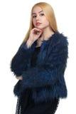 A menina em um casaco de pele Fotografia de Stock Royalty Free