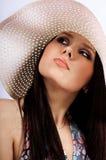 A menina em um chapéu fotografia de stock