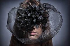 Menina em um chapéu bonito imagem de stock