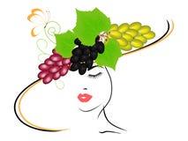 Menina em um chapéu com uvas e uma borboleta Fotos de Stock