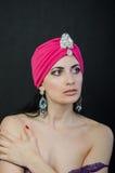 Menina em um chapéu vermelho Fotos de Stock Royalty Free