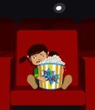 Menina em um cinema Imagem de Stock Royalty Free