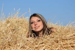 Menina em um feno Fotos de Stock
