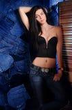 Menina em um fundo da sarja de Nimes com tela Imagem de Stock Royalty Free