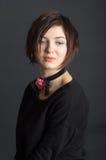 Menina em um fundo preto Imagens de Stock