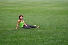 Menina em um gramado fotografia de stock royalty free