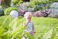 A menina em um jardim fotografia de stock royalty free