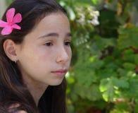 Menina em um jardim Fotos de Stock Royalty Free
