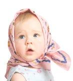 A menina em um lenço cor-de-rosa fotos de stock royalty free