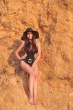 A menina em um maiô preto Imagem de Stock Royalty Free