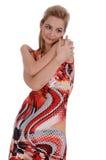 A menina em um many-colored sol-veste-se imagens de stock