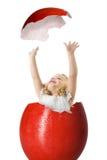 Menina em um ovo de easter Imagens de Stock