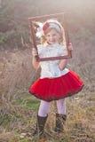 Menina em um quadro Imagem de Stock Royalty Free