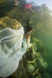 Menina em um rio imagens de stock royalty free