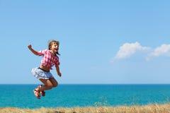 Menina em um salto fotografia de stock