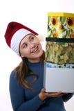 Menina em um tampão com três caixas Imagens de Stock Royalty Free
