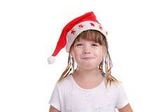 A menina em um tampão de Santa Claus Imagens de Stock Royalty Free