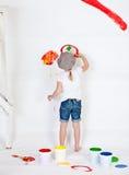 Menina em um tampão com pinturas Imagem de Stock