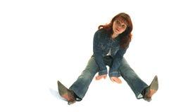 A menina em um terno das calças de brim imagens de stock