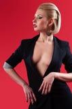 Menina em um terno preto Fotos de Stock Royalty Free